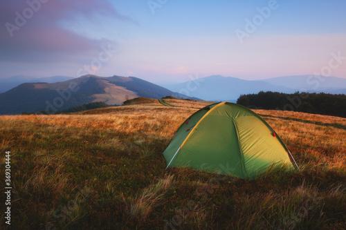 Fototapeta Green tent in spring mountains
