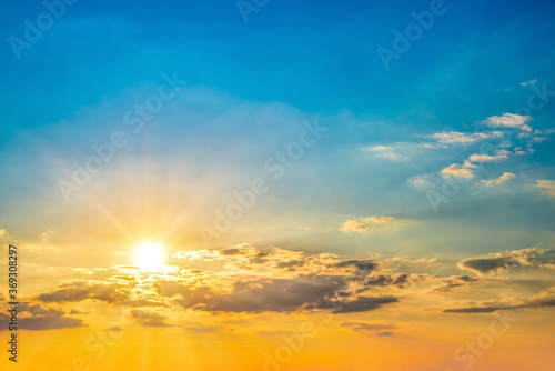 Fototapeta Beautiful blue summer sky with bright sun at sunset as a background obraz