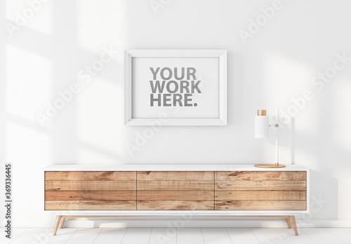 Obraz White Poster Frame Mockup Hanging on Wall Above Bureau - fototapety do salonu