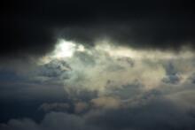 Sun Shining Through Dark Clouds.