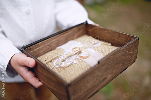 Fotografia, Obraz Wedding rings in a wooden box. Engagement ring