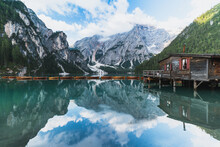 Picturesque View On Boathouse At Beautiful Mountain Lake Lago Di Braies With Wooden Boats In The Dolomites,Italy