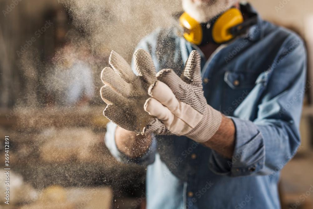 Fototapeta Close up of dusty work gloves