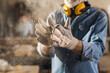 Leinwandbild Motiv Close up of dusty work gloves