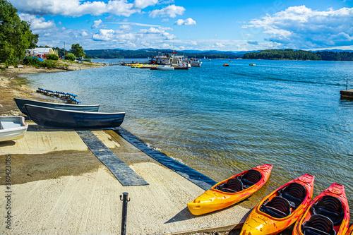 Obraz Canoes on the shore of the lake - fototapety do salonu