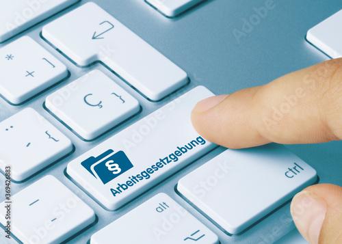 Valokuvatapetti Arbeitsgesetzgebung - Wort auf blauen taste.