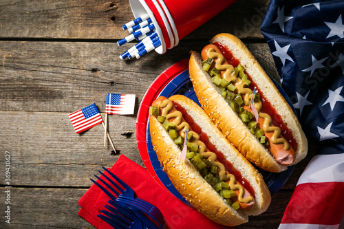 Obraz USA national holiday Labor Day, Memorial Day, Flag Day, 4th of July - hot dogs with ketchup and mustard on wood background, copy space - fototapety do salonu