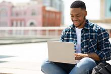 Glad Black Man Using Laptop, S...