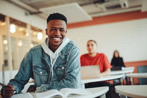 Obraz na plátně African student sitting in classroom