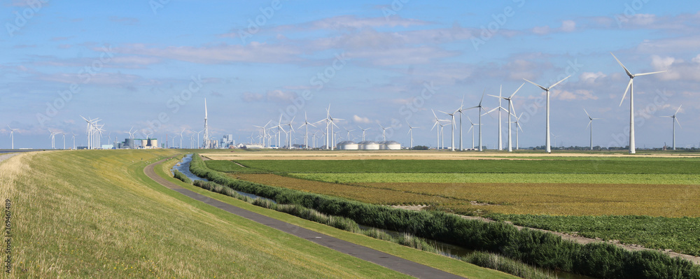 Fototapeta Panoramic summer view of the landscape and multi-fuel power station with wind turbines at Eemshaven, in Groningen, the Netherlands.
