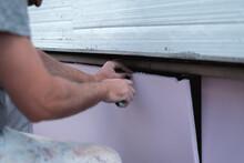 Worker Cutting Styro Foam With Precision Knife