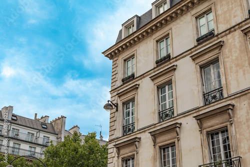 Fototapeta Typical old Paris architecture, facades of residential buildings with balconies and mansards obraz