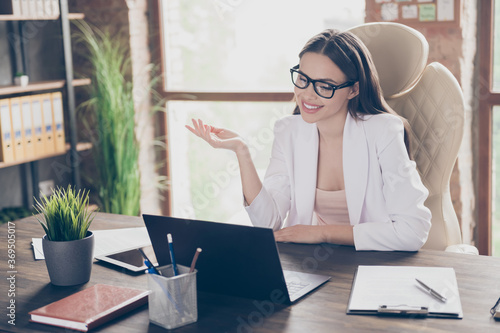 Obraz Portrait of her she nice pretty chic cheerful lady qualified skilled specialist talking video chat discussing agenda organize plan at modern industrial loft brick interior workplace workstation - fototapety do salonu