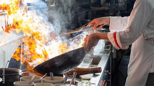 Fotografie, Obraz Chef stir fry cooking