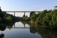 Morning View Of High Railway Bridge Over Valley With River. Bridge Is Mirroring On Calm Water Surface. Dense Green Vegetation On River Banks. Morning Serenity In Znojmo, Czech Republic.