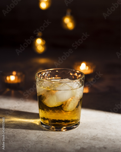 A glass of Whiskey and Ginger Ale in dark room with candlelight Canvas Print