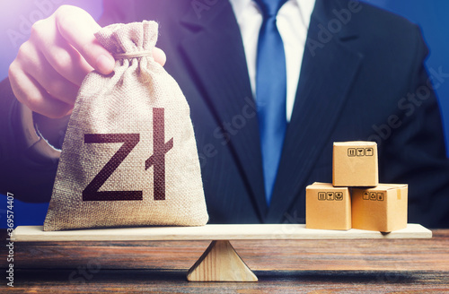 Obraz Polish zloty money bag and boxes on scales. Trade balance and purchasing power. Economic and industrial development. Import and export duties, profit from the sale of value added goods. VAT - fototapety do salonu