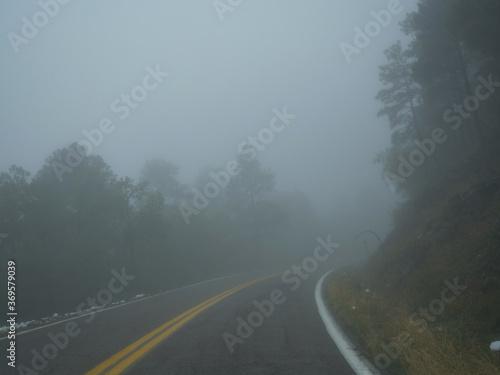 Fototapety, obrazy: A curvy mountain road leading into heavy fog