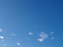 Blue Sky With A Few Clouds Background