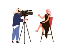 Woman Presenter Talking Sitting On Chair During Newscast Shooting. Video Operator Or Cameraman Holding Camera With Tripod Filming At Studio Isolated. Backstage Of Recording News Or TV Show