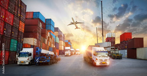 Fotografía Container truck in ship port for business Logistics and transportation of Contai