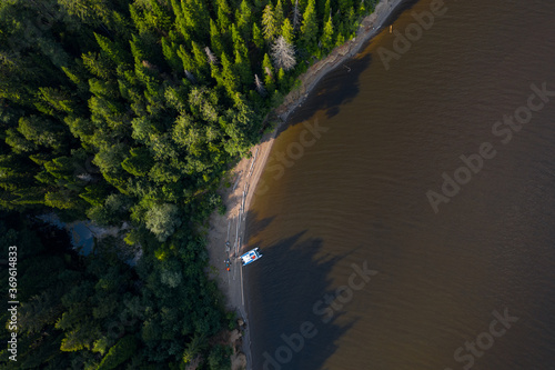 Obraz Aerial view of the wild narrow beach with anchored white vessel - fototapety do salonu