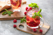 Cup Of Cold Raspberry Tea On Grey Background