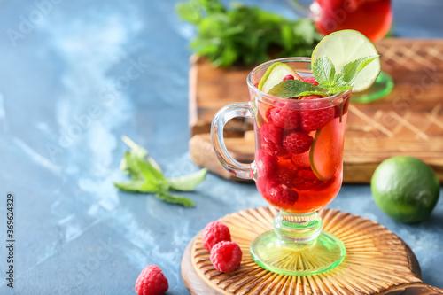 Obraz Cup of cold raspberry tea on table - fototapety do salonu