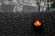 Tea Candle In Brass Cup On The...