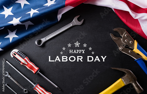 Fototapeta Happy Labor day concept. American flag with different construction tools on black table background, with copy space for text. obraz