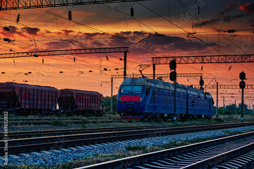 railway train and rail cars in a beautiful sunset, dramatic sky and sunlight Canvas