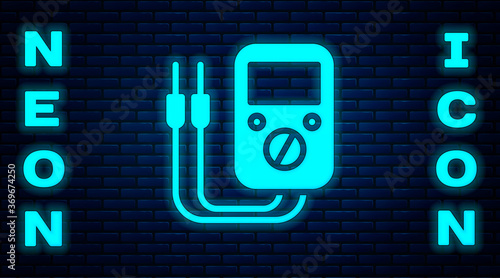 Glowing neon Ampere meter, multimeter, voltmeter icon isolated on brick wall background Canvas Print