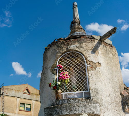 figure of a latticed virgin inside a tower in an abandoned building used for pra Canvas Print