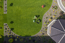 Gardener Maintaining Residential Yard Area.