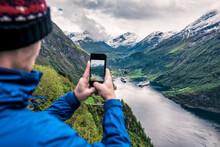 Tourist Takes Photo Of Geirang...