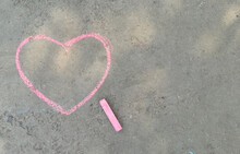 Pink Heart Drawn With Chalk On The Asphalt. Love Confession. Banner Place For Text, Valentine, Children Creativity Copy Space, Summer