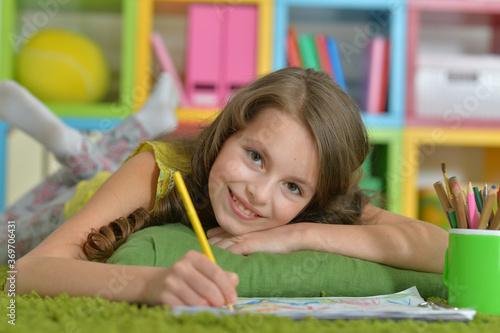 Portrait of cute smiling girl drawing at home Tapéta, Fotótapéta