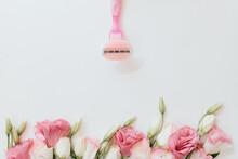Pink Razor With Blades On A Li...