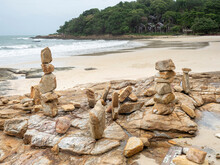 Stone Stack On Beach In Samed, Thailand. Cloudy And Big Waves.