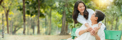 Mother and daughter hug and smiled together on chair in garden, concept of mothe Wallpaper Mural