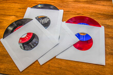 Vintage 45 Rpm Records With White Sleeves