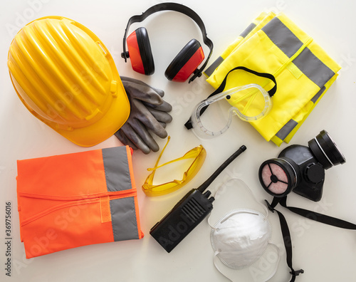 Obraz Work safety protection equipment background. Industrial protective gear on white - fototapety do salonu