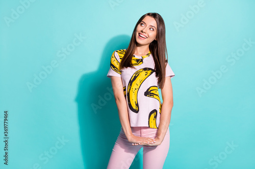 Photo of minded dreamy girl look copyspace imagine thoughts incredible summer vacation wear fruit print clothes isolated over turquoise color background