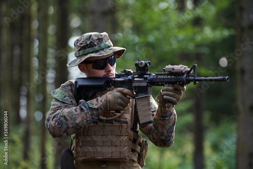 Slika na platnu soldier in action aiming  on weapon  laser sight optics