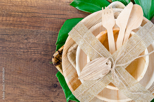 Obraz Kitchenware made from dried betel nut leaf palm, natural material. - fototapety do salonu