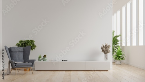 Obraz Interior of a bright living room with armchair on empty white wall background. - fototapety do salonu