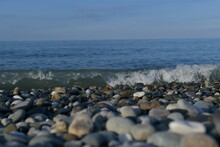 Seascape, View From The Pebble Shore On The Rushing Swirling Wave.
