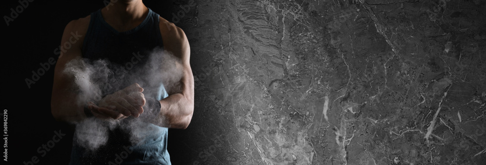 Fototapeta Collage with photo of strong man applying magnesium powder in modern gym and grunge surface. Banner design, space for text