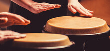 Close Up Of Musician Hand Playing Bongos Drums. Rum. Hands Of A Musician Playing On Bongs. The Musician Plays The Bongo