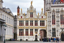 Historic Buildings Of The Brugse Vrije With The Old Civil Registrar Building On The Right On The Burg Square In The Heart Of The Medieval City Of Bruges, Belgium